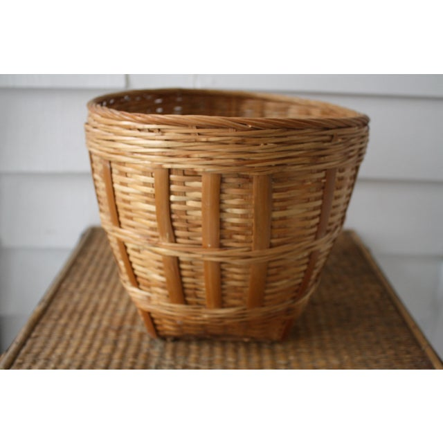Vintage woven basket! A lovely rattan basket that would add a perfect touch of Boho chic to your mantel or bookcase. It's...