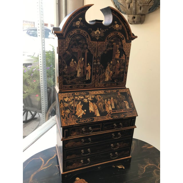 Early 20th century Chinoiserie desk form cabinet fitted with drawers.