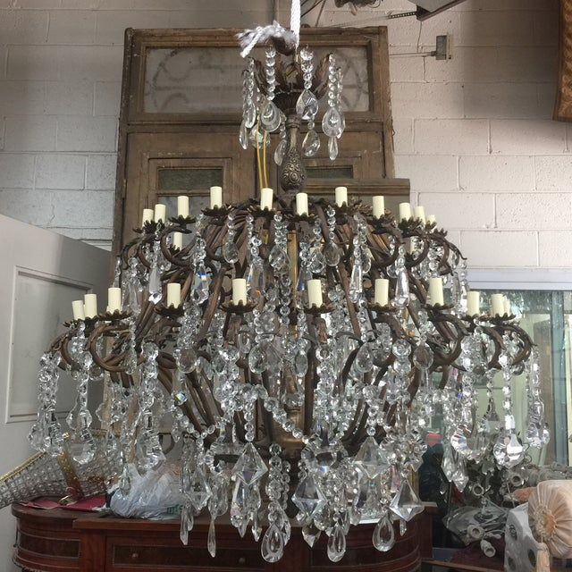 Absolutely stunning crystal chandelier with the various designs on crystals including scallop design, teardrop design, art...