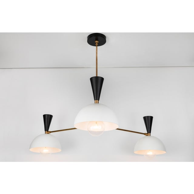 Large three-cone 'Lola II' chandelier in black and white. Hand-fabricated by Los Angeles based designer and lighting...