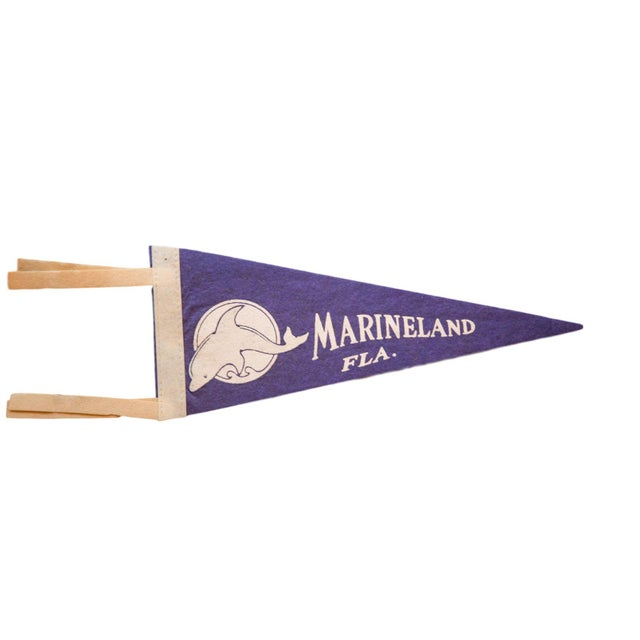 :: Vintage souvenir felt flag pennant from Marineland FL with a simple uncolored image of a dolphin above a circle with a...