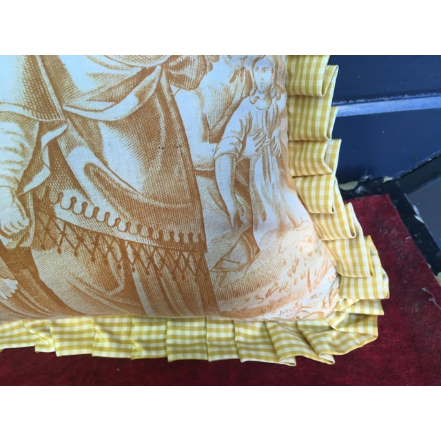 A pillow made from a circa 1880's scenic toile depicting The Chastity of Joseph. Mary Jane McCarty Collection