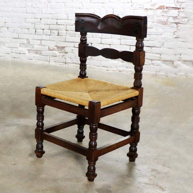 Handsome Spanish Colonial or Spanish Revival style dining chairs with natural rush seats and large nail head detail....