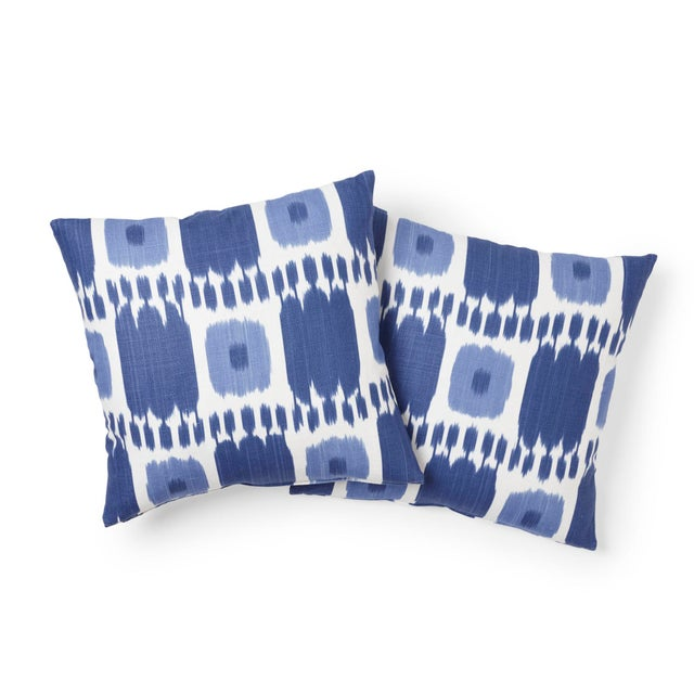 "This 18"" x 18"" pillow features Kandira in Blues, a playful checkerboard graphic derived from woven ikats. In a classic..."