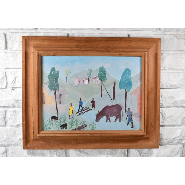 Signed by artist Nicolas Dreux. Depicts a Haitian village/farm scene with architecture, people, and animals such as pigs...