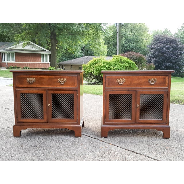 A timeless pair of Chippendale style cabinet banded nightstands by luxury furniture maker, Henredon. These are from the...