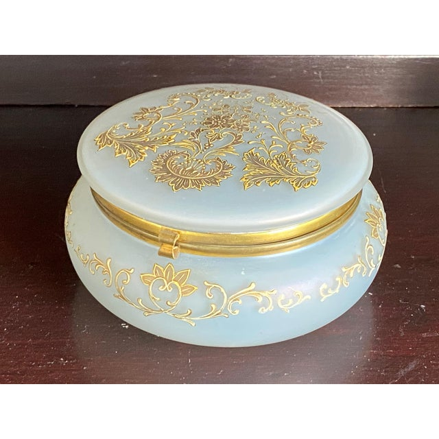 Large round white opaline glass dresser box with 24k gold paint flowers and scrolls.