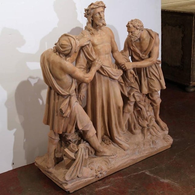 This large, antique sculpture depicts the tenth station of the cross and was crafted in France, circa 1860. Excellent...