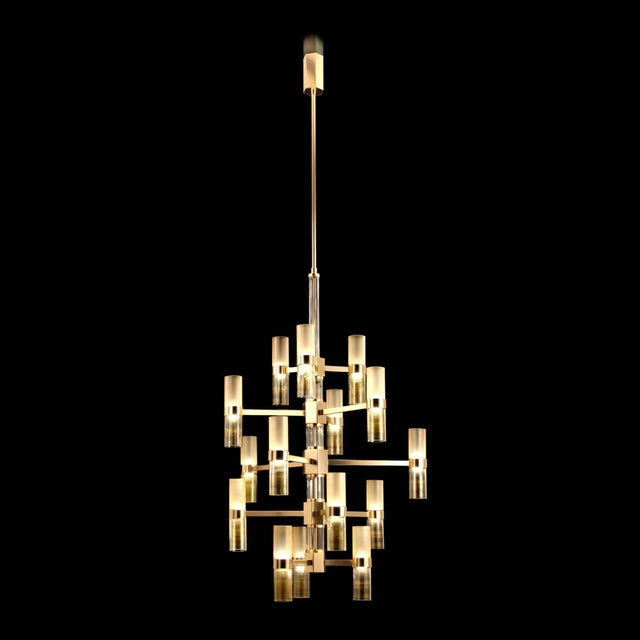 Italian modern Murano glass chandelier with amber satin tubes and clear and gold tubes, on polished gold metal finish by...