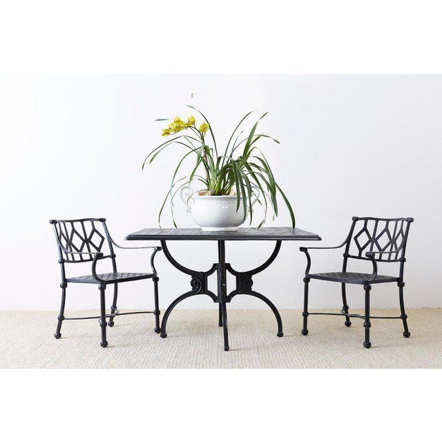 Impressive patio and garden dining table made in the manner and style of Molla. Constructed from ebonized cast aluminium...