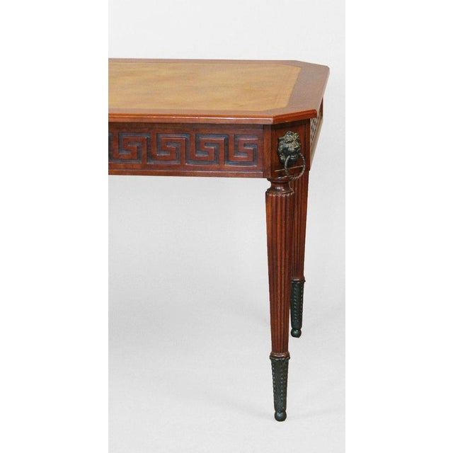 Regency style desk/library table having two drawers, turned and reeded legs, and Greek key motifs on four sides. Custom...