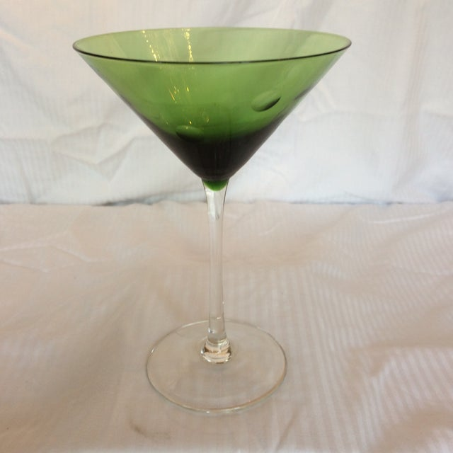 A put together set of a stunning emerald green glass with brushed metal lid cocktail shaker and 2 bubble glass martini...