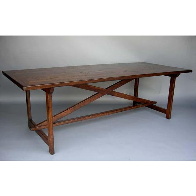 Custom St. Anthony table in walnut with framed top on an trestle base. Finished in medium walnut with distress and range...