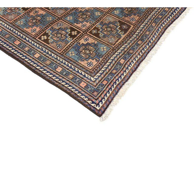 This vintage Shiraz Persian rug displays a compartment-panel pattern featuring geometric motifs with a meticulous level of...