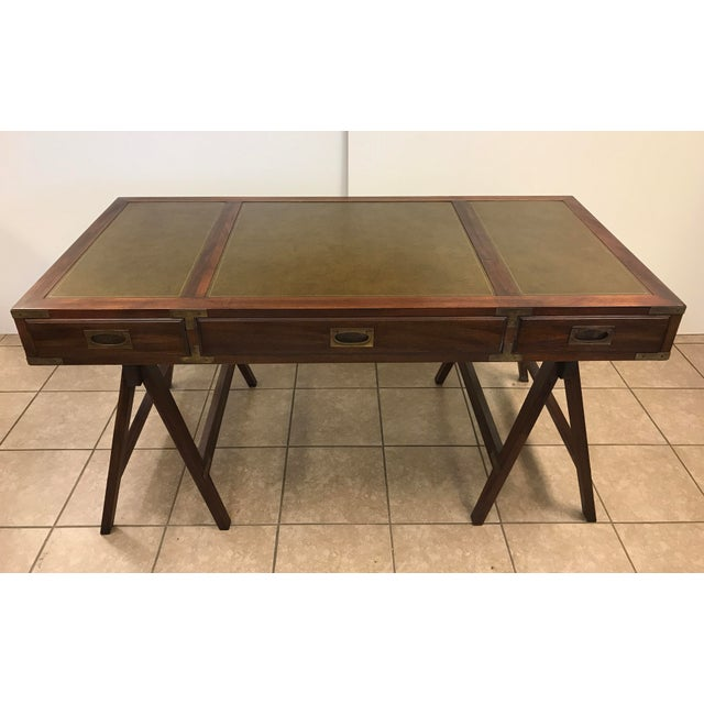 Rosewood and brass Campaign desk with leather top. Has three pull-out drawers and original brass handles.