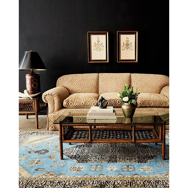 Bespoke Jonas New York three-seat upholstered sofa featuring an English style rolled arm design. This grand sofa is...