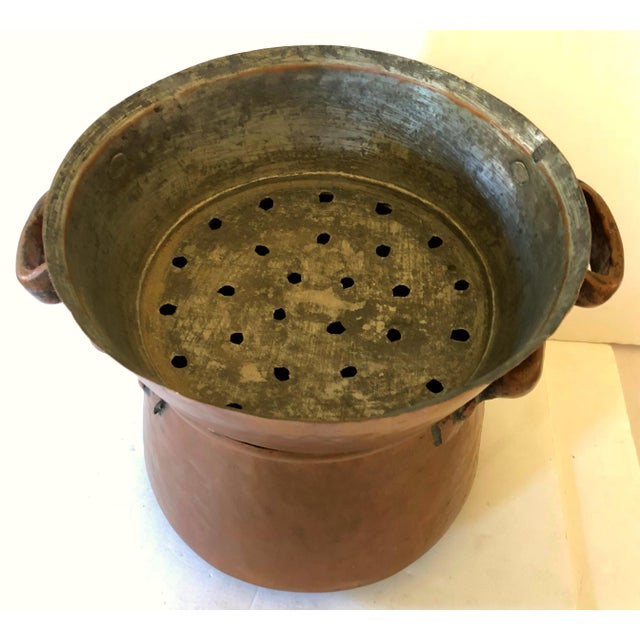 Wonderful French hand forged copper pot with fitted colander on top. Side seam is dove-tailed and substantial handles...