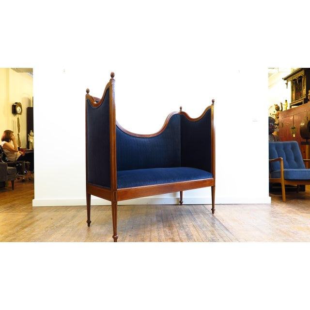 American Sheraton style settee, loveseat, bench, circa 1900. Magnificent Settee that transcends several stylistic...