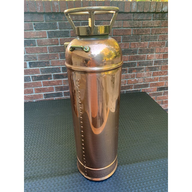 "Full Size (24"") Copper and Brass Fire Extinguisher. This Unit is Complete With Hose and Nozzle. 24"" Tall x 8"" Diameter...."