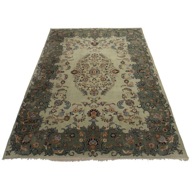 Here is a vintage Persian Kashan rug. Made of hand-knotted wool. Has a large medallion design.