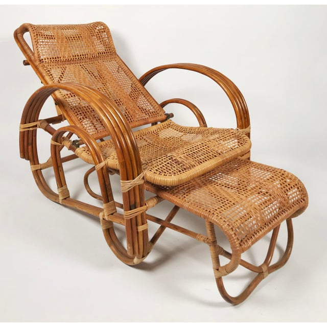 Vintage 1920's bamboo and cane reclining lounge chair with attached pull out ottoman. Reclines to three different...