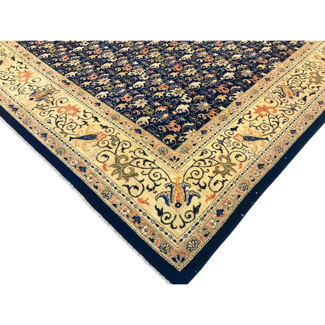 Stunning deep blue hand knotted rug is intricately designed by master artisans. This beautiful blue rug features an...