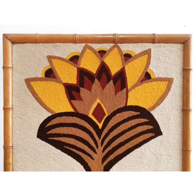 Rare earth toned Luis Montiel hand hooked tapestry. 70s folk modern textile framed in faux bamboo. Exceptionally clean...