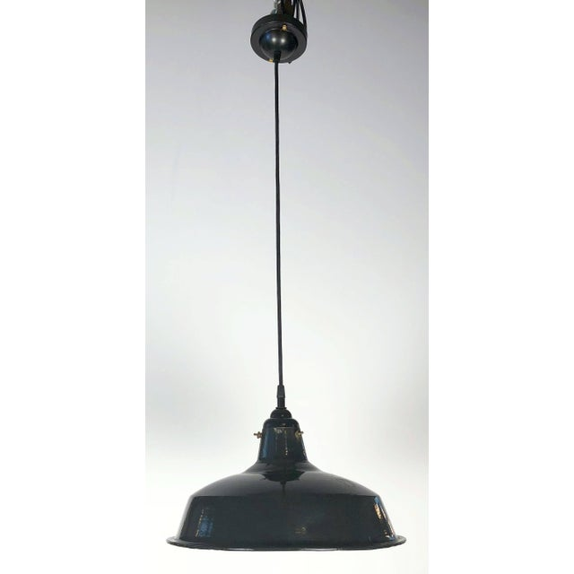 Two black enameled tole Industrial hanging (fixture) lamps or lanterns from England, each one featuring a factory sized...
