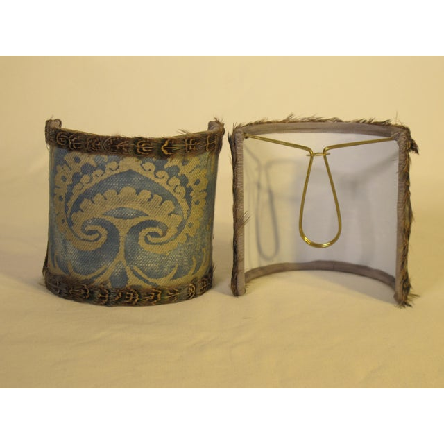 A pair of sconce shades that are hand made with an antique Fortuny fabric in the Sevigne pattern, the shades are...