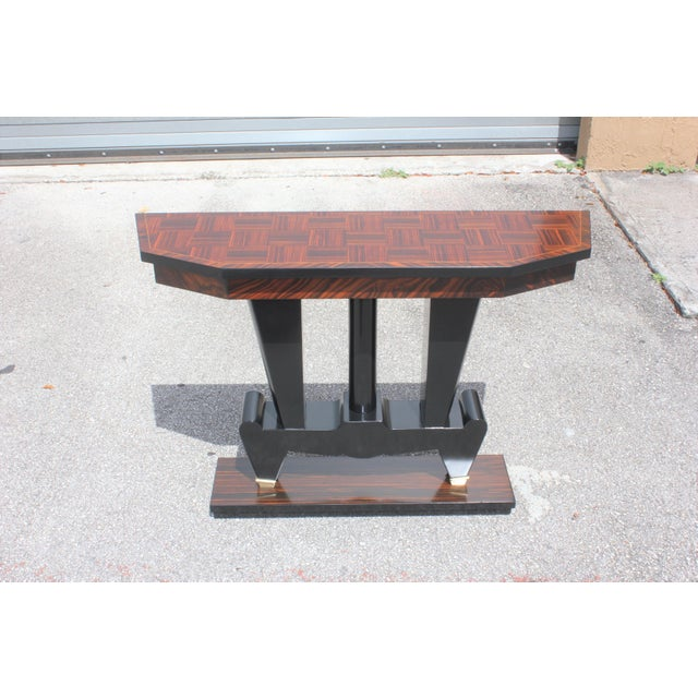 Beautiful French Art Deco exotic Macassar ebony console table, circa 1940s. Beautiful Macassar ebony with black lacquer...