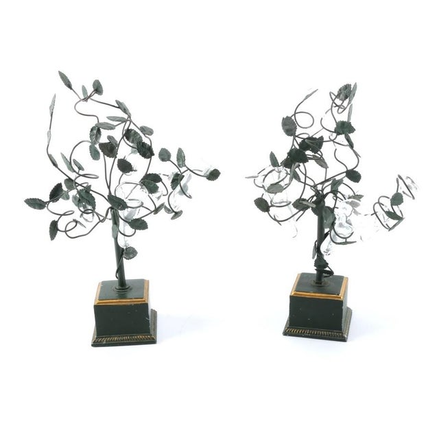 A pair of vintage Italian tole topiary trees with epergne glass vases. Each of these metal sculptures depicts a small...