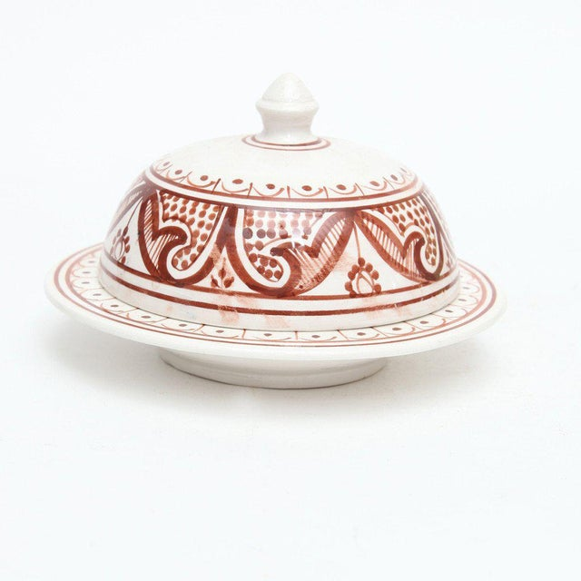 With its signature dome-shaped ceramic lid and low, rounded base, this handcrafted medium-sized Moroccan tajine pot makes...