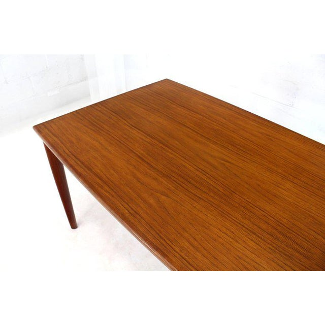 """Danish Mid-Century Modern teak medium size refractory dining table with 2 x 22"""" long extension leafs. Very study thick..."""