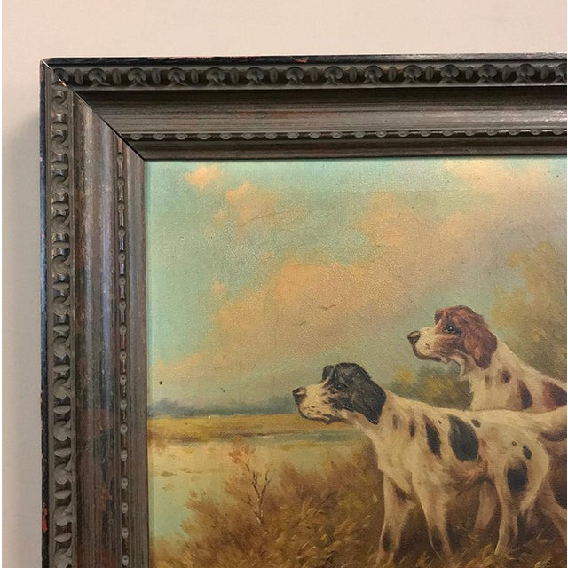 19th Century Framed Oil Painting on Canvas by Paul Schouten depicts a handsome pair of pointers in the field with the...