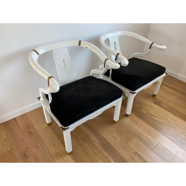 A pair of gorgeous vintage Ming chairs in white lacquer reupholstered in the softest black Belgian velvet. The velvet...