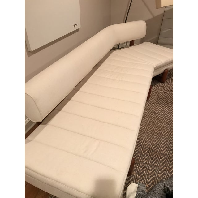 Jonathan Adler's Aspen Sofa in Like New condition. Built with solid mahogany legs and floating back cushion. The angled...