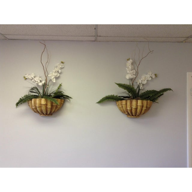 Wonderful pair of vintage bamboo inspired wall planters with quality silk orchid and fern arrangement in moss. The...