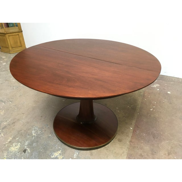Incredible Round Pedestal base expandable dining table by T.H. Robsjohn-Gibbings for Widdicomb Furniture Company. Modern...