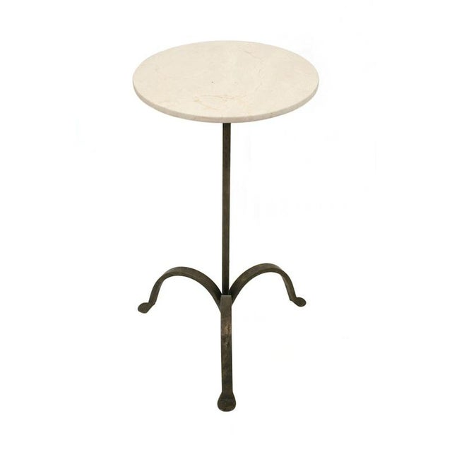 Circular iron tripod table with a crema marfil marble top and light traces of gilding. BK Limited Edition, custom sizes...