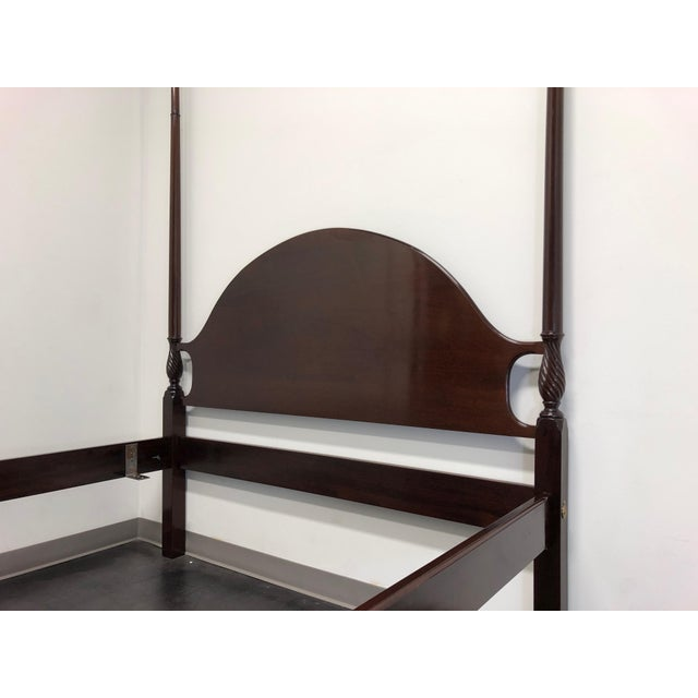 A superior quality four poster bed in solid Mahogany. Chippendale style with ball in claw feet. This bed is unmarked but...