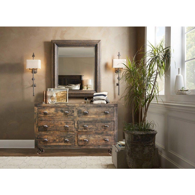 You will love this traditional-style wooden chest for its many storage spaces. It is enhanced by a rich natural finish...