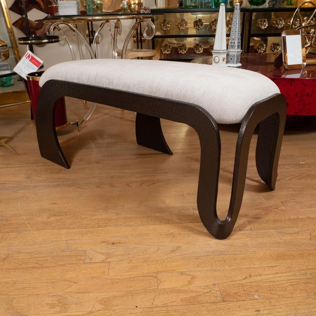 Rectangular upholstered bench with patinated iron frame.