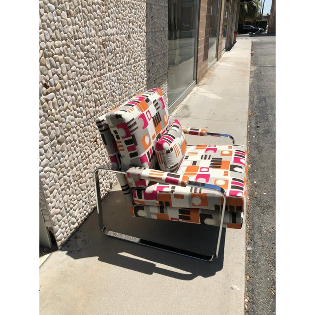 This modern chrome club chair was made in the 1970s. In the style of the iconic Milo Baughman chrome arm chair. The chair...