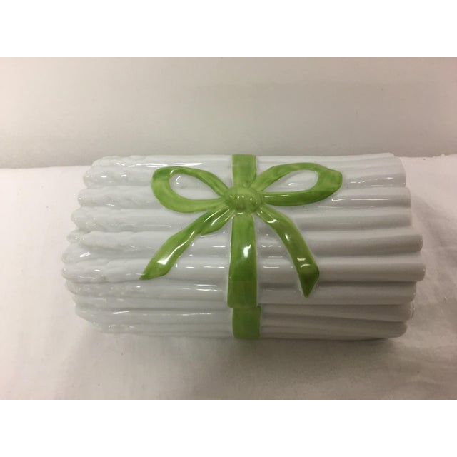 Beautiful and cheery Mottahedeh asparagus covered box with green ribbon bow . Pristine condition. Made in Portugal ....
