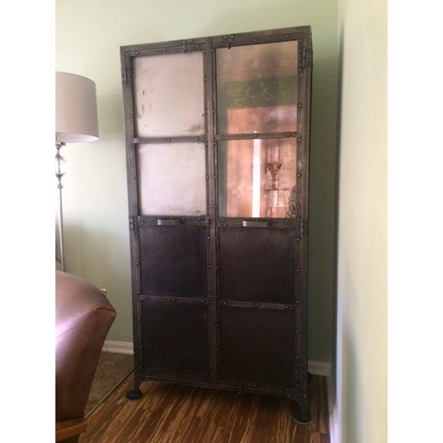 This cabinet is from Arhaus and features a beautiful patina on the metal and one door has an antiqued mirror front. The...