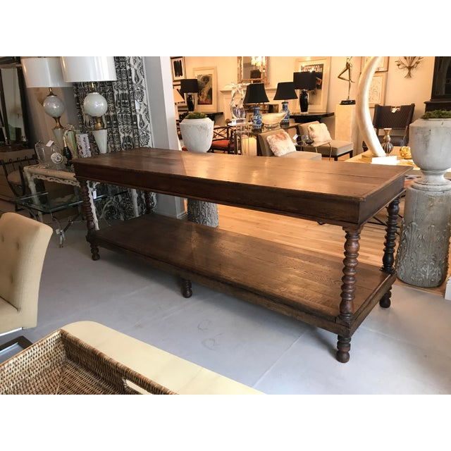 This is a beast of a table. Solid oak with the most beautiful patina and shelf on the bottom. This piece would be perfect...