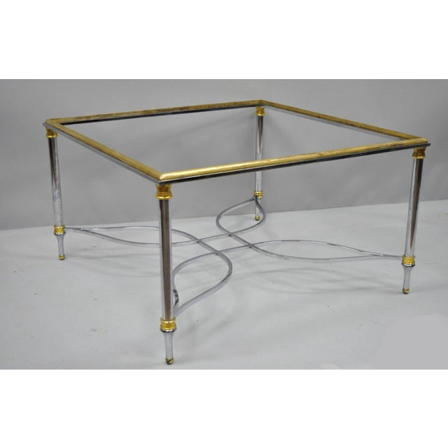 Maison Jansen Style Chrome Steel and Brass Square Coffee Table Base. Item features star form stretcher, brass rim and...
