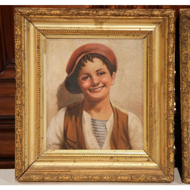 This charming pair of antique paintings on board were painted in Italy circa 1870. The portraits, signed in the lower left...