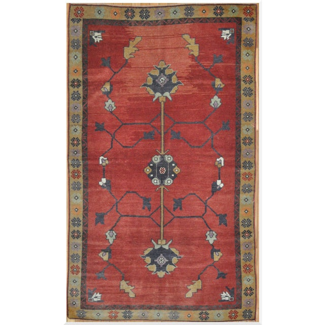 This is a beautiful vintage hand knotted tribal design rug. It is made with pure wool and cotton and rich natural dyes....