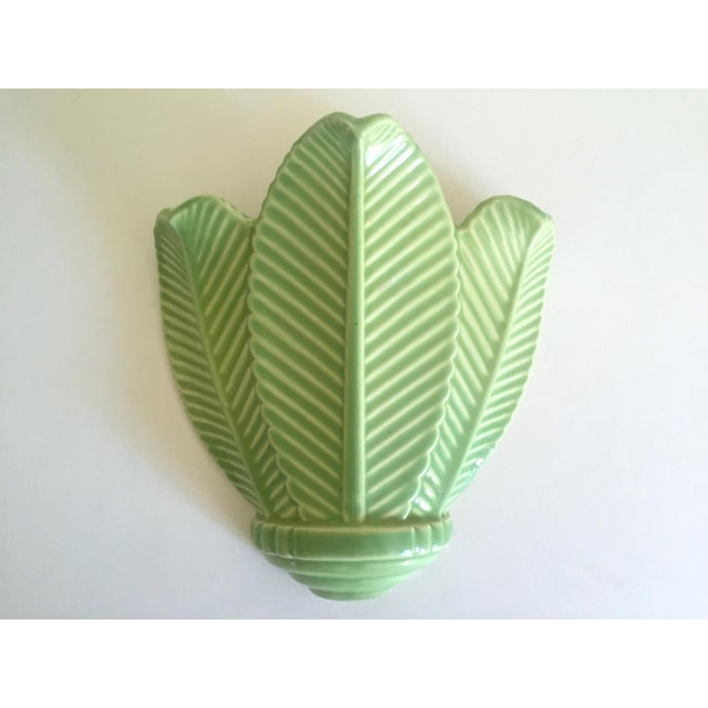 This vintage Mid Century Art Deco style pistachio mint green art pottery palm leaf ceramic wall pocket vase is a very...